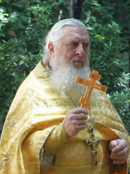 Father Andrei Semyanko with cross